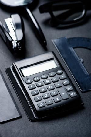 calculator with various office utensils mock-up 版權商用圖片