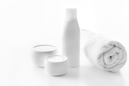 different skin cream or body lotion and towel Reklamní fotografie - 80407186