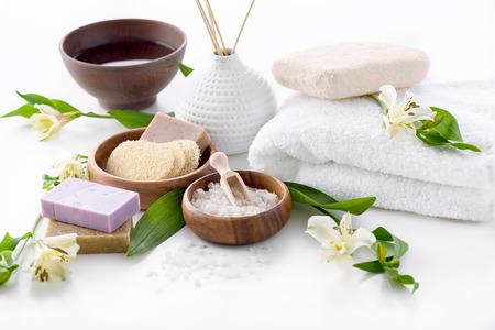 handmade soap, sea salt and towel isolated on white