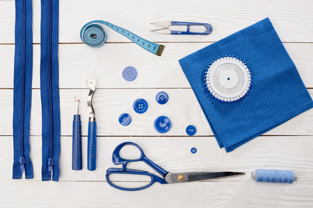 fancywork: top view of workshop with needlework details and tools mock-up