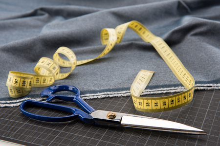 fabric, scissors and measuring tape for dressmaking
