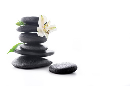 Zen stones with flower isolated on white