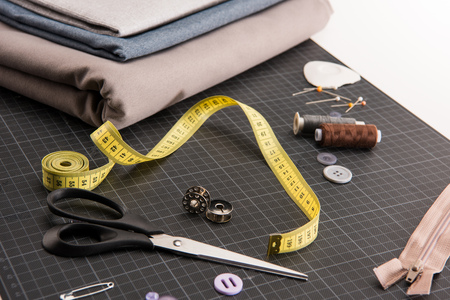 set of various sewing supplies on table Stock Photo