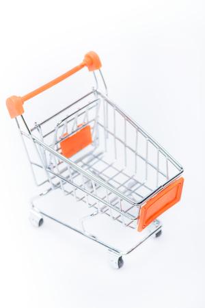 little metallic empty shopping cart isolated on white