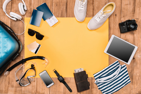 Summer holiday background with travelers accessories on wooden floor