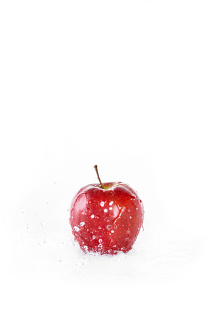 red fresh apple with water drops isolated on white, fresh fruits background Stock Photo
