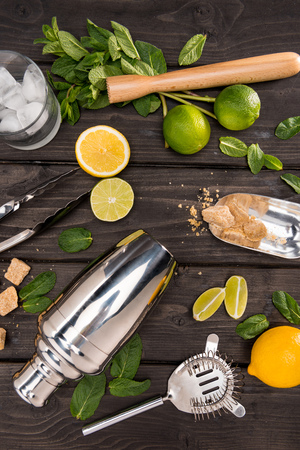 Top view of mojito cocktail ingredients and utensils on wooden table top, cocktail drinks concept Stock Photo