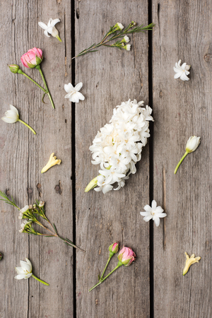 Top view of beautiful blooming flowers collection on wooden table top Banco de Imagens