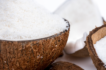 close up view of ripe organic coconut with sweet shavings