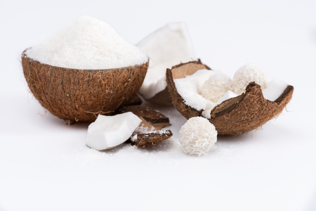Close-up view of ripe coconut with shavings and sweet tasty candies