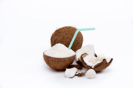 tasty coconut with shavings and straw, whole coconut and sweet candies Imagens