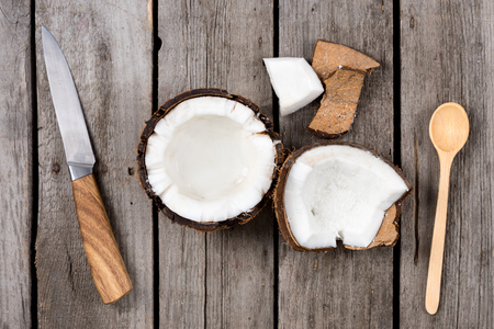 pieces of fresh tropical coconut with knife and spoon