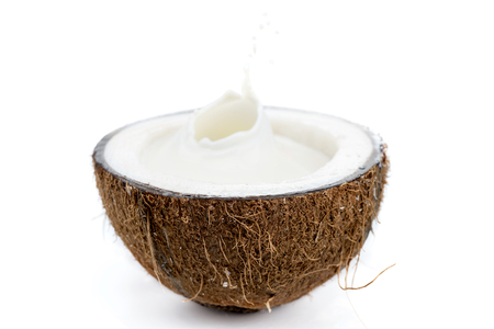 fresh ripe tropical coconut half with milk isolated on white, coconut milk
