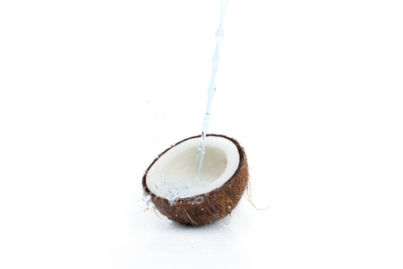 fresh ripe tropical coconut with water isolated on white Stock Photo