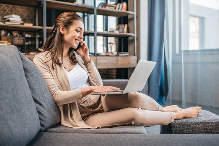 Businesswoman remote working and using laptop