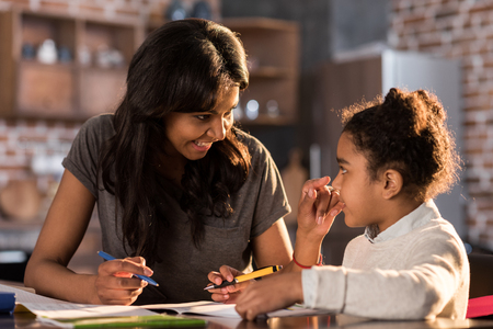 mother and daughter learning together and doing homework, homework help concept Stock Photo