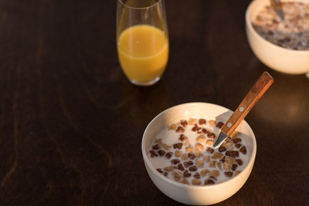 breakfast at home with orange juice and corn flakes with milk Banco de Imagens