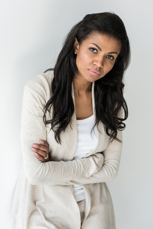 attractive african american woman with crossed arms looking at camera