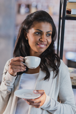 african american woman drinking coffee at home, breakfast