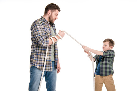 Father and son holding rope isolated on white Stock Photo