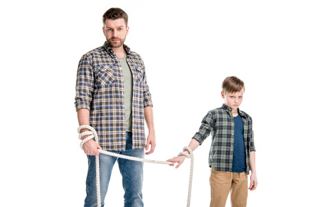argue kid: Father and son holding rope isolated on white Stock Photo