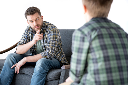 argue kid: Father pointing with finger at little son