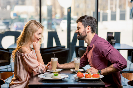 couple in love having lunch in restaurant together Imagens