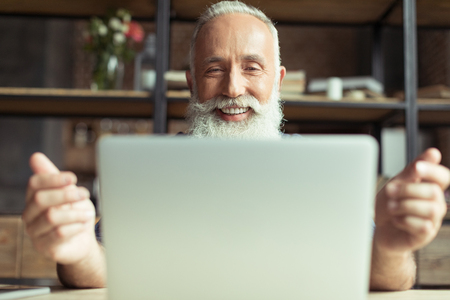smiling man using laptop at home office workplace Stock Photo - 80407385