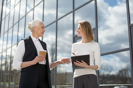businesswomen on meeting outdoors near office building