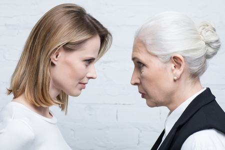 Side view of serious women looking at each other