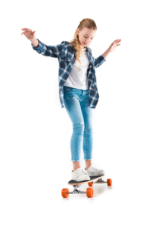 happy girl with skateboard isolated on white in studio