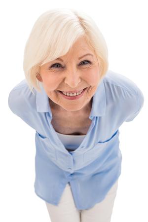 happy senior woman looking at camera