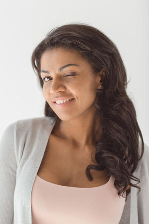 portrait of beautiful young african american woman winking