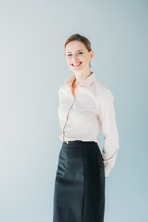 portrait of young attractive caucasian businesswoman in formalwear smiling