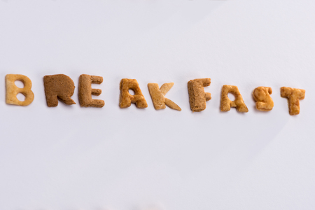 word breakfast from alphabet corn flakes isolated on grey