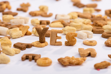 word yes and healthy breakfast cereal alphabet isolated on white Banco de Imagens