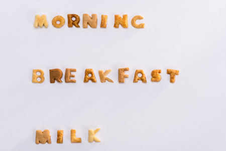 words morning, breakfast, milk from alphabet corn flakes isolated on grey