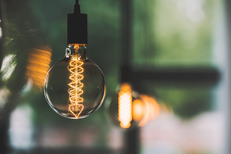 vintage edison light bulb hanging with other light bulbs indoors
