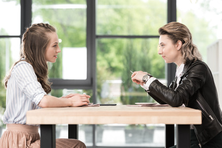 lesbian couple spending time together on coffee break