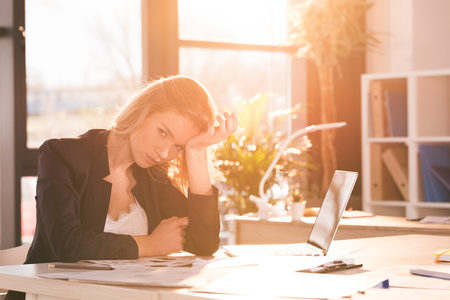 businesswoman sitting at workplace and working in modern office Reklamní fotografie