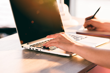 partial: businesswoman working with laptop computer at workplace in office Stock Photo