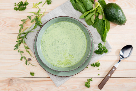 green creamy soup with fresh healthy ingredients on table Imagens - 80649966