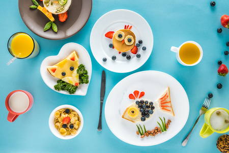 hotcakes: top view of food styling breakfast with various dishes on blue background Stock Photo