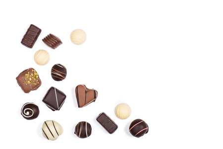 Flat lay of assortment of sweet delicious chocolate candies isolated on white Stock Photo