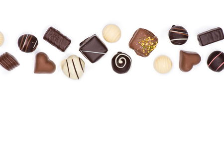 Top view of various gourmet chocolate candies isolated on white