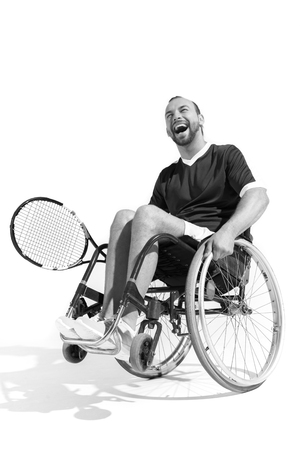 black and white photo of happy disabled tennis player in wheelchair