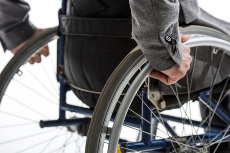 cropped shot of physically handicapped man on wheelchair isolated on white Stock Photo