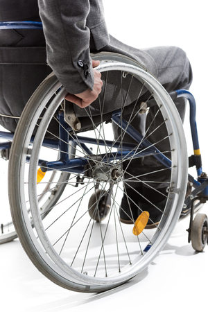 cropped shot of physically handicapped man on wheelchair