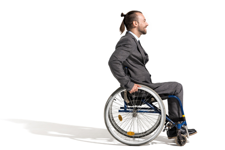 side view of smiling disabled businessman in wheelchair