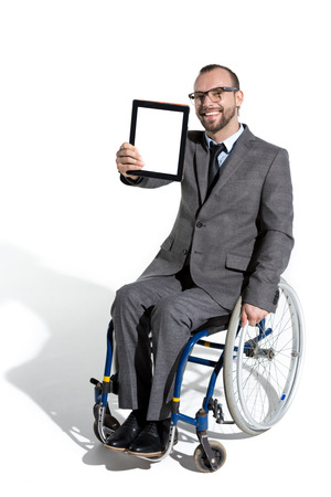 physically handicapped businessman in wheelchair with digital tablet